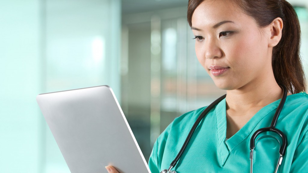 Portrait of a Female doctor holding a digital tablet.